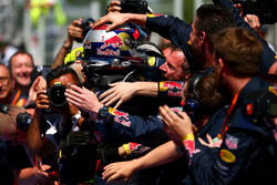 Max Verstappen, Red Bull Racing celebrates in parc ferme with the Red Bull Racing team after his first win