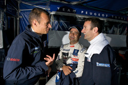 Stéphane Sarrazin, Pedro Lamy and Nicolas Minassian in the Team Peugeot Total pit area