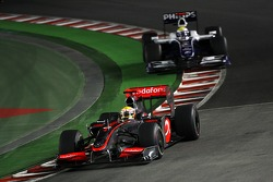 Lewis Hamilton, McLaren Mercedes leads Nico Rosberg, WilliamsF1 Team