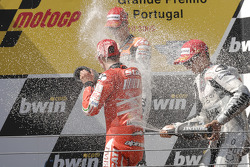 Podium: race winner Jorge Lorenzo, Fiat Yamaha Team celebrates with second place Casey Stoner, Ducati Marlboro Team, third place Dani Pedrosa, Repsol Honda Team