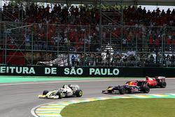 Rubens Barrichello, BrawnGP leads Mark Webber, Red Bull Racing at the start