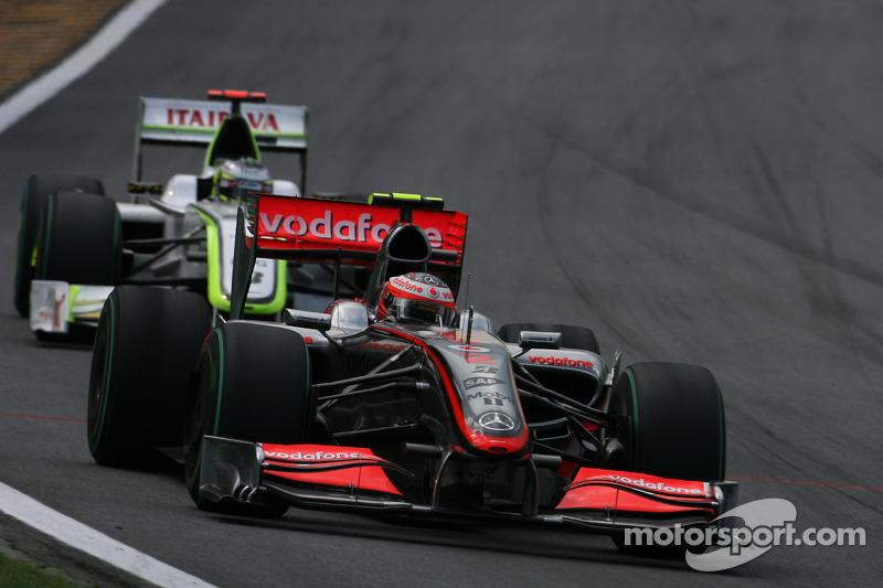 Heikki Kovalainen, McLaren Mercedes and Jenson Button, Brawn GP