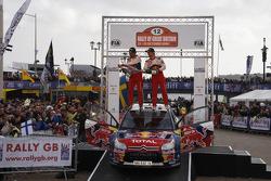 Podium: winners and 2009 WRC champions Sébastien Loeb and Daniel Elena