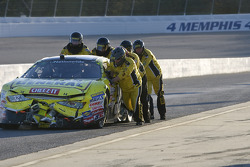The No. 32 Dollar General Stores Toyota crew push their car down pit road