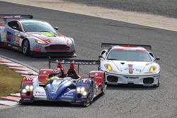 #10 Team Oreca Matmut - AIM Courage-Oreca LC70 - AIM: Nicolas Lapierre, Loic Duval, #85 Jim Gainer Racing Ferrari F430 GT: Tetsuya Tanaka, Katsiyuki Hiranaka