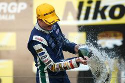 Podium: Mark Winterbottom celebrates his victory