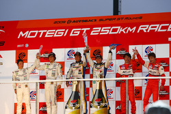 GT300 Championship podium: champions #19 Wedssport IS350 Manabu Orido, Tatsuya Kataoka, second place #7 M7 Mutiara Motors Amemiya SGC-7: Nobuteru Tanigichi, Ryo Orime, third place #11 Jimgainer Advan F430: Tetsuya Tanaka, Katsiyuki Hiranaka