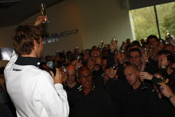 Jenson Button celebrates 2009 world championship with Brawn GP staff