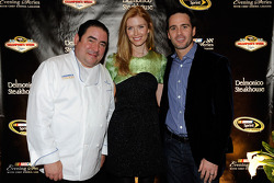 Chef Emeril Lagasse, Chandra Johnson and four time NASCAR series Champion Jimmie Johnson attend a NASCAR Evening with Emeril Lagasse at Delmonico Steakhouse in the Venetian Resort Hotel & Casino