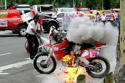 #73 Honda of Pizzolito Javier catches fire right before the start