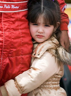 Paulina, daughter of Juan Pablo Montoya, clings to his leg