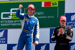 Giacomo Ricci celebrates his victory on the podium with Alvaro Parente