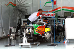 The Force India team work on their cars