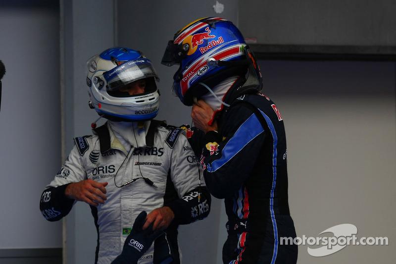 Polepositie Mark Webber, Red Bull Racing met Rubens Barrichello, Williams F1 Team