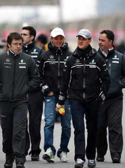Nico Rosberg, Mercedes GP and Michael Schumacher, Mercedes GP walk the circuit