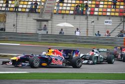 Sebastian Vettel, Red Bull Racing leads Michael Schumacher, Mercedes GP