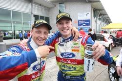 Winner Jari-Matti Latvala celebrates with teammate Mikko Hirvonen