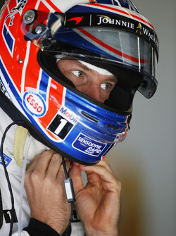 Jenson Button, McLaren MP4-31 adjusts his crash helmet