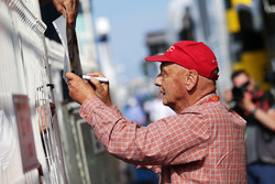 Niki Lauda, Mercedes Non-Executive Chairman signs autographs for the fans