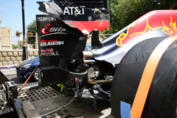 The damaged Red Bull Racing RB12 of Daniel Ricciardo, is recovered back to the pits on the back of a truck