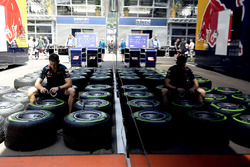 A Red Bull Racing mechanic with Pirelli tires
