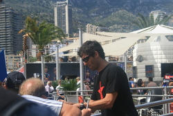 Mark Webber doing autographs