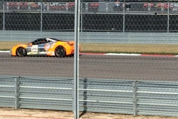 Carlos is hard on the brakes at the entrance to turn 12