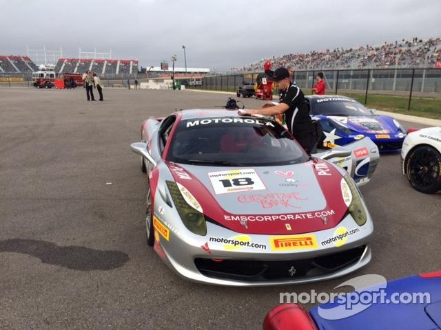 Auto Gallery Motorsports Technician Dave Cameron monitors Jim Weiland's 458 Italia