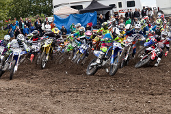 Yamaha rider Jimmy Decotis #105 edges out Honda's Jeremy Medaglia #21  holeshots in the MX2 class