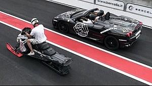 Snowmobile head to head drag race versus two Ferrari